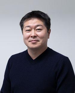 専務取締役 佐藤 慎一郎
